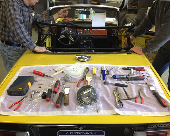 What tools does it take to install a new top on a 1974 TR6?