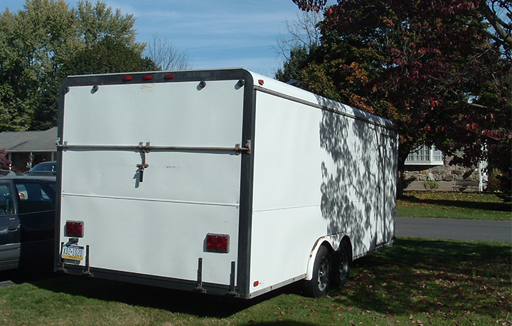 The back of our 20-foot white trailer.