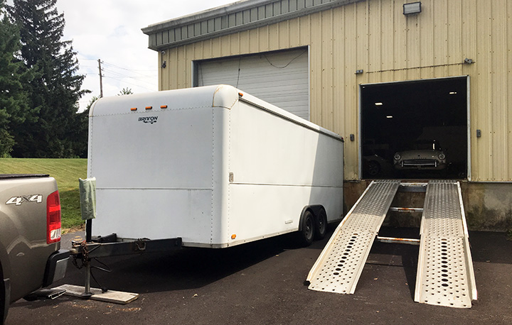 Our white 20-foot trailer at the shop loading dock and ramp,.